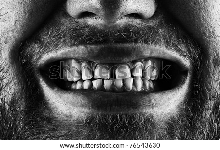 Close-up of a scary screaming bearded mouth - stock photo