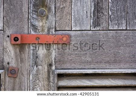 Close up of a sealed and locked up wooden door. - stock photo