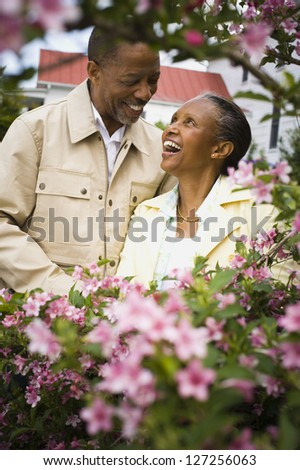 Close-up of a senior man and a senior woman looking at each other - stock photo