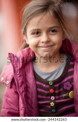 Close up of a seven year old beautiful girl smiles - stock photo