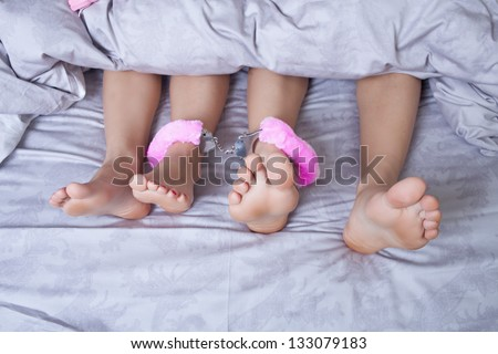 Close up of a sexy couple kissing and playing in bed - stock photo