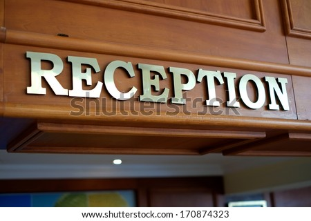 "Close-up of a shiny sign with the word ""reception"". - stock photo"