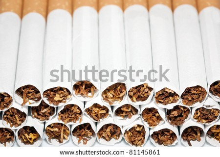 Close up of a smoking cigarettes in a stack - stock photo