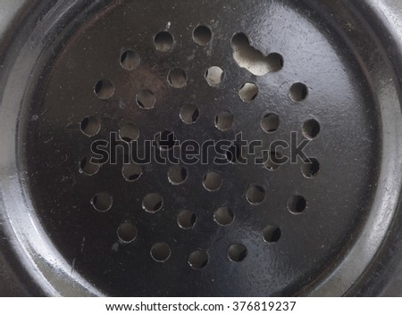 Close-up of a speaker in a vintage telephone receiver - stock photo