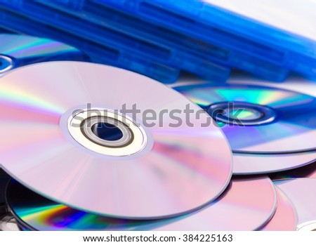 Close up of a stack compact discs (CD/DVD) - stock photo