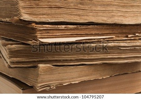 Close-up of a stack of old books - stock photo