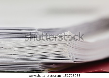 close up of a stack of paper, shallow depth of field - stock photo