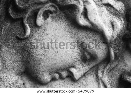 Close up of a stone carved face of an  angel - stock photo