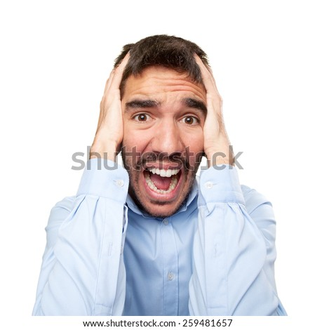 Close up of a stressed young man - stock photo
