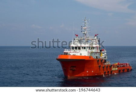 Close-up of a supply vessel transporting cargo to nearby rigs - stock photo