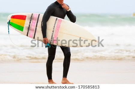 Close up of a surfboard on a beach - stock photo