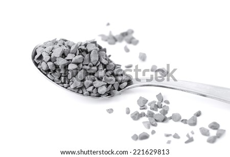 Close up of a teaspoon of instant coffee granules, isolated on a white background - monochrome processing - stock photo