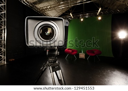 Close-up of a Television Camera lens in a green screen studio environment. - stock photo
