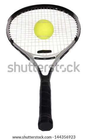 Close-up of a tennis racket with a tennis ball - stock photo