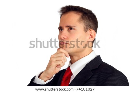 Close-up of a thoughtful young man in a suit - stock photo