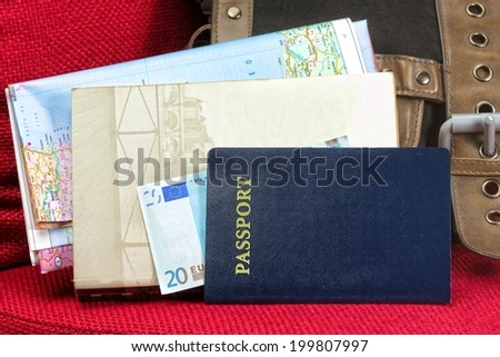 Close up of a traveling documents- passport, ticket, map and money. - stock photo