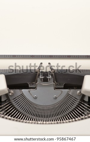 Close up of a typewriter with a blank paper inserted - stock photo