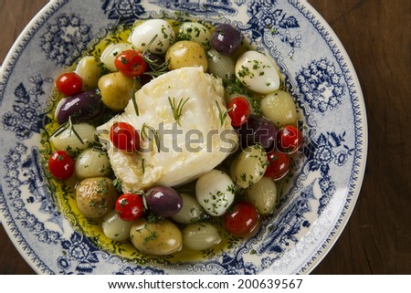 Close up of a typical Portuguese dish with codfish called Bacalhau do Porto in a original portuguese plate seem from above - stock photo
