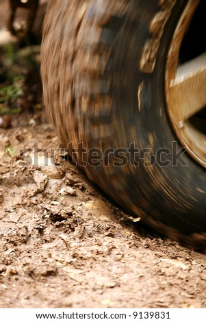 Close up of a tyre on an off road vehicle in motion. - stock photo
