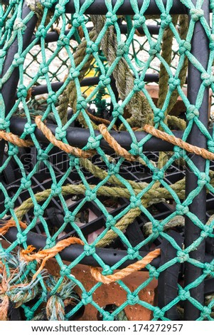 Close up of a UK lobster pot with green twine/net. - stock photo