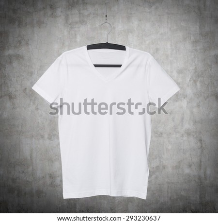 Close up of a V shape white t-shirt on cloth hanger. Concrete background. - stock photo
