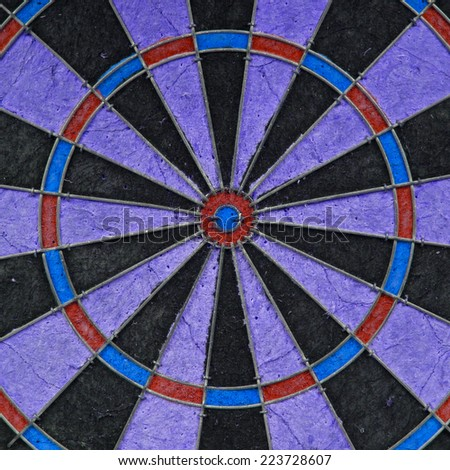 Close-up of a very old unique dartboard, isolated - stock photo