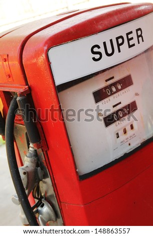 Close up of a vintage Red super fuel pump - stock photo