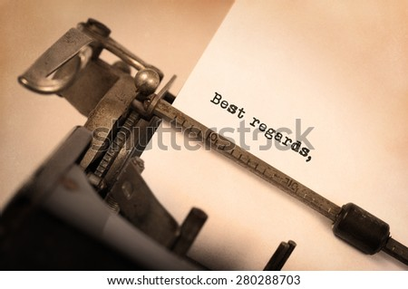 Close-up of a vintage typewriter, old and rusty, best regards - stock photo