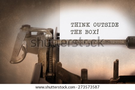 Close-up of a vintage typewriter, selective focus, think outside the box - stock photo
