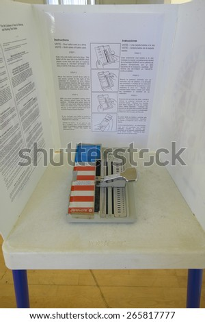Close-up of a voting booth and ballot machine, CA - stock photo