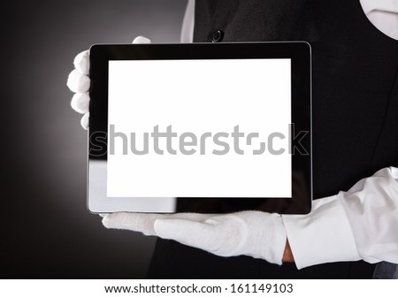 Close-up Of A Waiter Hand Showing Blank Digital Tablet - stock photo