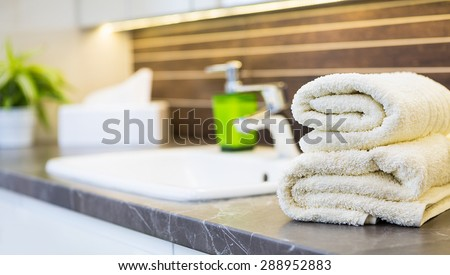 Close up of a wash basin in a modern bathroom interior. - stock photo