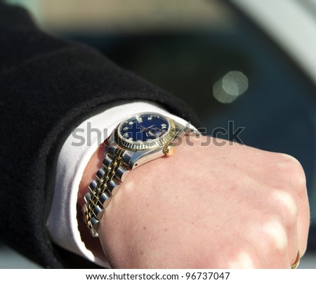 Close up of a watch on humans arm - stock photo