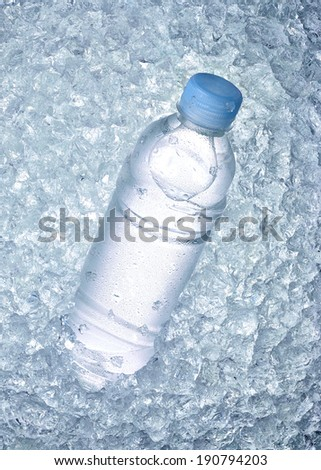 close up of a water bottle in ice - stock photo