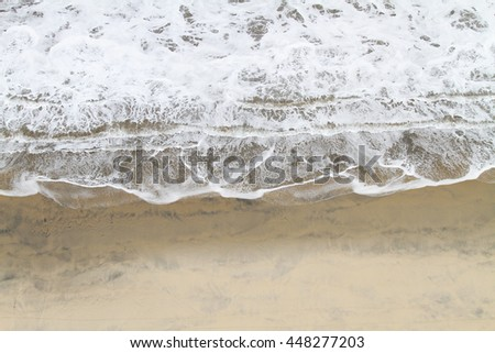 Close up of a wave coming into shore - stock photo