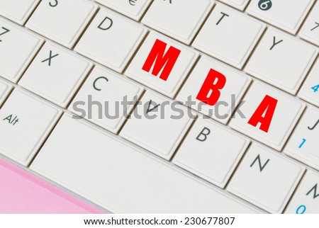 """close up of a white and pink laptop keyboard with """"MBA"""" keys - stock photo"""