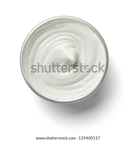 close up of a white beauty cream or yogurt on white background with clipping path - stock photo