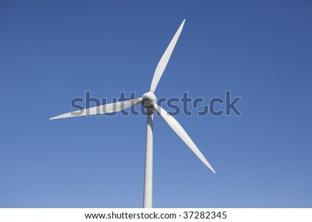 Close up of a wind turbine at a wind farm - stock photo