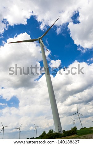 close up of a wind turbine on a wind farm - stock photo