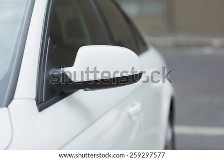 Close up of a wing mirror of white car - stock photo