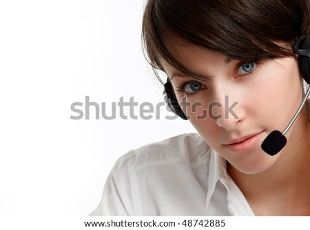 close-up of a woman helpline operator with headset - microphone and headphones, on white - stock photo