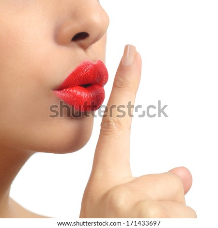 Close up of a woman lips with finger asking for silence isolated on a white background              - stock photo