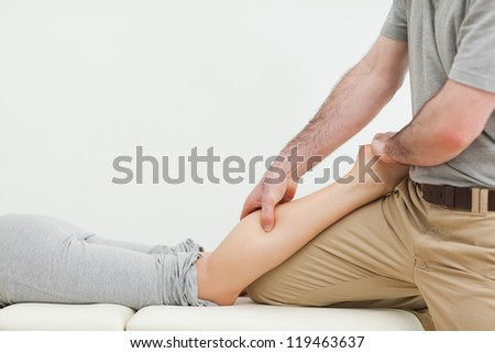 Close-up of a woman lying while being massaged in a room - stock photo