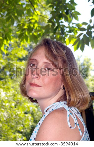 Close up of a woman posing in a state park - stock photo