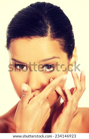 Close up of a woman putting contact lens in her eye - stock photo