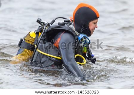 Close-up of a woman, scuba-diver gear - stock photo