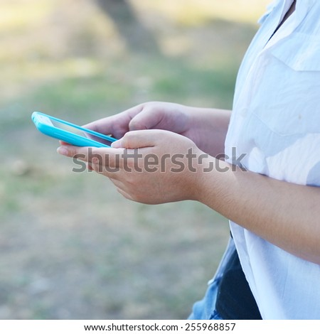 Close up of a Woman using mobile smart phone - stock photo
