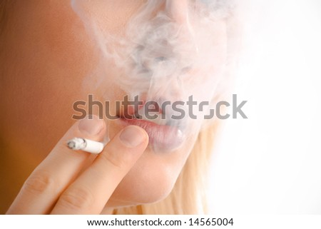 close up of a woman with cigarette - stock photo