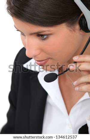 close-up of a woman with headset - stock photo