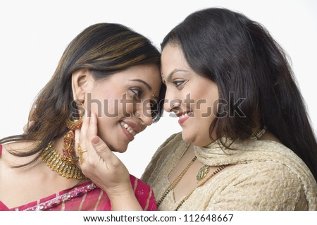 Close-up of a woman with her daughter - stock photo